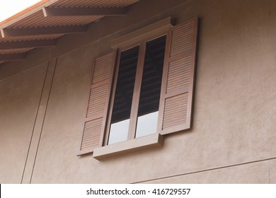 brown wooden window with tinted glass