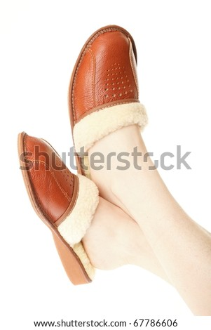 0be8e88e73e brown wool comfortable slippers on the foot - house slipper isolated on  white background