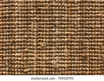 Brown woven sisal or nature fiber carpet texture and background