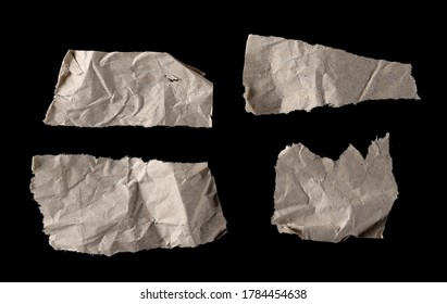 Brown wrinkly paper scraps set and collection isolated on black background and texture, top view