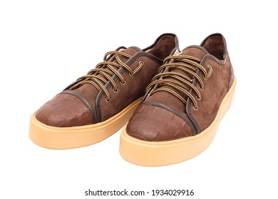 brown or yellow boots shoes for foot and adventure travel place on vintage white floor or table with copy space