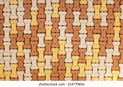 Brown, yellow and white dog biscuits as an abstract tessellated background texture
