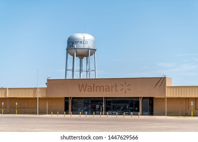 Brownfield, USA - June 8, 2019: Texas countryside industrial town with old vintage run-down Walmart and water tank with sign