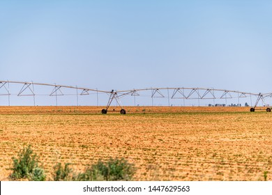 Brownfield, USA Texas countryside industrial field with water or fertilizer chemicals sprayer on dry land