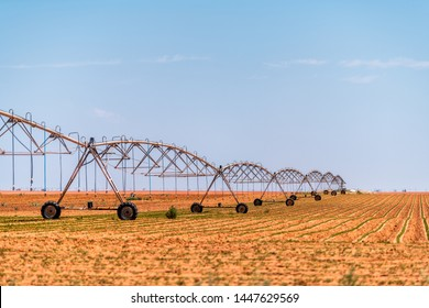 Brownfield, USA Texas rural countryside industrial field with water or fertilizer chemicals sprayer on dry land