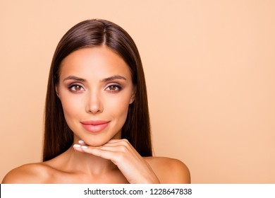 Brown-haired charming well-groomed dreamy leisure lifestyle lady with her naked shoulders she hold hand under chin look at camera isolated on pastel beige background with copy space for text