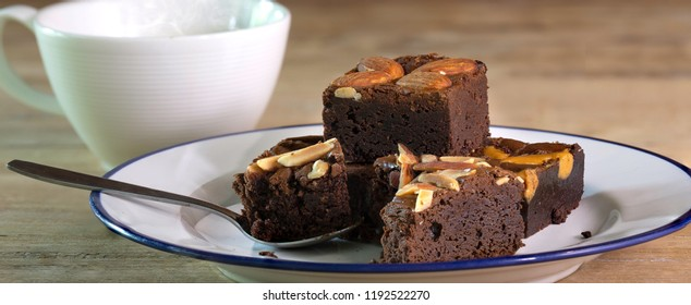 Brownie cake and black coffee on wooden table / space for messages and select focus and adjustment size for banner, cover, header