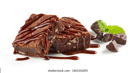 brownie cake pieces with chocolate sauce isolated on white background