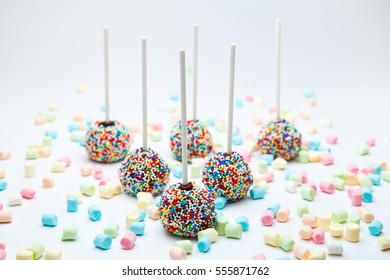 Brownie cake pops with color sugar pearls and marshmallow
