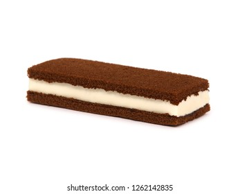 Brownie cake sandwich filled with milk cream isolated on white