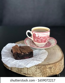 Brownie with a cup of coffee on a wooden tray