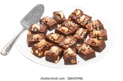 Brownie dessert on a white plate, on white background.