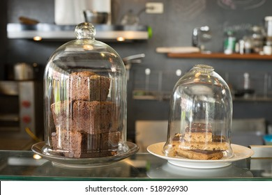 Brownies and cake inside transparent glass cup