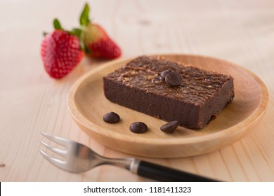 Brownies Chocolate Cake, homemade bakery on wooden background, selective focus, copy space
