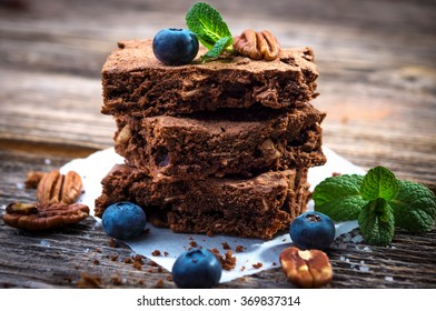 Brownies on wooden background