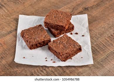 Brownies on wooden under wax paper