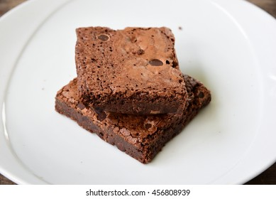 Brownies are typically eaten by hand, often accompanied by milk or coffee. They are sometimes served warm with ice cream (à la mode), topped with whipped cream, or sprinkled with powdered sugar.