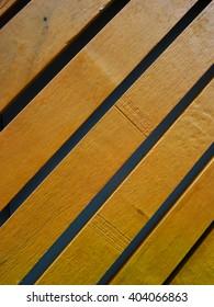 Brownish yellow painted diagonal wood planks