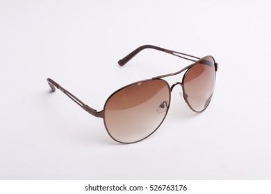 99d2091ebd Brown-rim eyeglasses in white background.