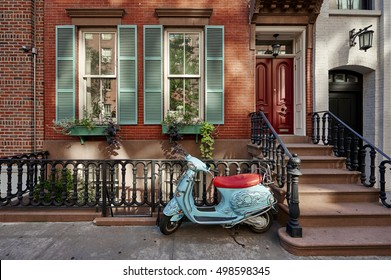 a brownstone building with a vintage scooter in a famous neighborhood of Manhattan, New York City.