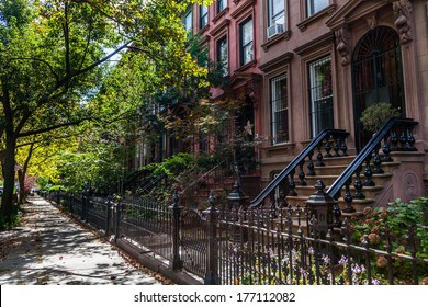 Brownstone Homes along residential Neighborhood sidewalk in Brooklyn New York