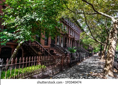 Brownstone Homes along residential Neighborhood sidewalk in Brooklyn, New York