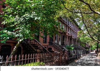 Brownstone Homes along residential Neighborhood sidewalk in Brooklyn, New York