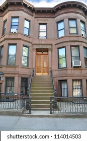 Brownstone Residence Building Steps leading to door air conditioner in window