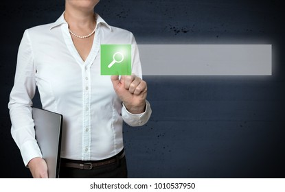 Browser touchscreen is shown by businesswoman.
