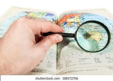 Browsing the map through a magnifying glass on a white background
