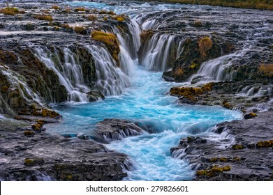 Bruarfoss (Bridge Fall), is a waterfall on the river Bruara, in southern Iceland where a series of small runlets of water runs into a beautiful, turquoise-blue colored pool.