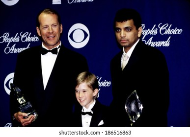 Bruce Willis, Haley Joel Osmont, M, Night Shyamalan, with People's Choice Awards for SIXTH SENSE, Circa January 2000