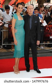 Bruce Willis and wife Emma Heming arriving for the UK Premiere of Red 2, at Empire Leicester Square, London. 22/07/2013