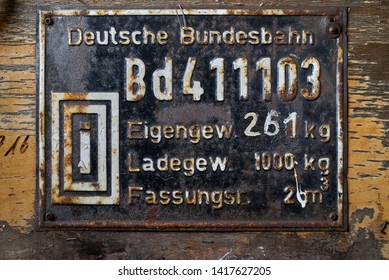 Bruchhausen-Vilsen, Germany - May 19, 2019: vintage metal plate on a historic train with informations about weight and volume of a waggon