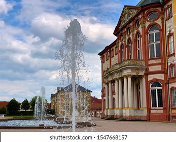 BRUCHSAL, GERMANY - MAY 7, 2019 Medieval residency of bishop with water fountain.