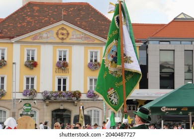Bruck an der Mur, Austria - September 11, 2021: Folk festival with different groups in traditional costumes going through the main square in styrian Bruck an der Mur in Austria.