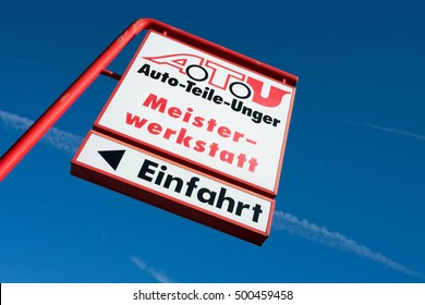 BRUEHL, GERMANY - October 16, 2016: A.T.U signpost against blue sky. A.T.U is a large car repair shop chain and retailer for car components with ca. 600 branches in Germany, Austria and Switzerland.