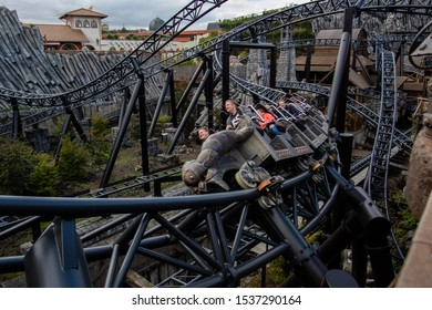 Bruehl, Germany - October 5, 2019: Attractions in the leisure park Phantasialand. Vacationers in the park ride a roller coaster
