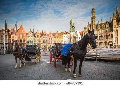 BRUGES - APRIL 5, 2017: Medieval style buildings near the market place (Grote Markt) in Bruge. Bruge is the capital city of the province of West Flanders in the Flemish Region of Belgium.