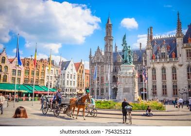 BRUGES, BELGIUM 13 JULY, 2017: Beautiful Market Square (Markt) in Bruges, Belgium.