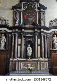 Bruges, Belgium - 2014: The Madonna of Bruges is a marble sculpture by Michelangelo of Mary with the Child Jesus. It now sits in the Church of Our Lady in Bruges, Belgium.