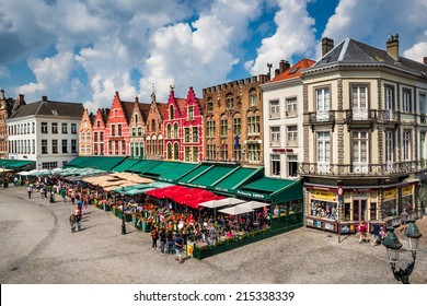 BRUGES, BELGIUM - 7 AUGUST 2014. Tourists in north side of Grote Markt (Market Square) of Bruges, Brugge, with enchanting street cafes, meeting place of the Brugelings and tourists. Flanders.