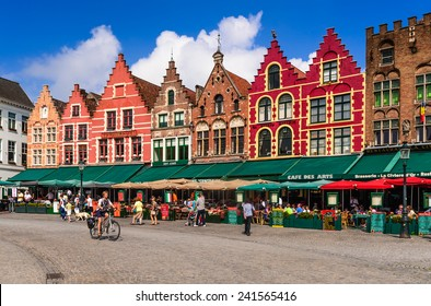 BRUGES, BELGIUM - 7 AUGUST 2014. Tourists on street cafes in Bruges, Markt is meeting place of the Brugelings and tourists in Brugge, Flanders.