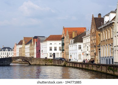 BRUGES, BELGIUM - APRIL 20, 2014: Old bridge over the central canal in Bruges