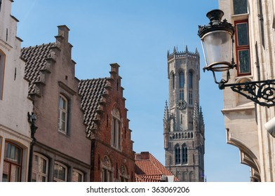 BRUGES, BELGIUM - APRIL 24, 2010: View of the famous belfry (bell tower) and houses
