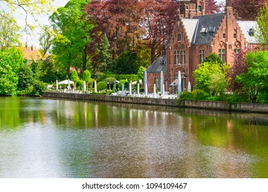 BRUGES, BELGIUM - APRIL 25, 2018: The neogothic Castle de la Faille by the Lake of Love in Bruges was built in 1893 to a design by Charles De Wulf. It was bought by the city of Bruges in 1980.