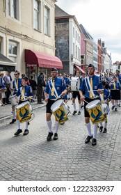 "Bruges, Belgium - august 13, 2017 : The ""Koninklijke Speelschaar Sint-Franciscus-Xaverius Brugge"" fanfare corps marching through the street of Bruges."