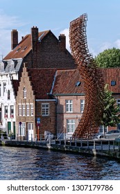 Bruges, Belgium - August 13, 2018: Lanchals art installation by John Powers in the form of a swan's neck. Inspired by the legend of Pieter Lanchals - an adviser of Archduke Maximilian of Austria.