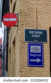 Bruges, Belgium - August 13, 2018: Do Not Enter traffic sign and bicycles direction sign.