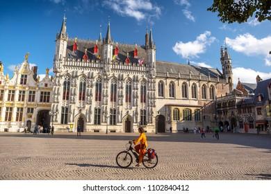 Bruges, Belgium - August 17, 2017: Tourists near a town hall in Brugge, Belgium. Brugge - the main town of the Belgian province the Western Flanders. One of the most picturesque cities of Europe.